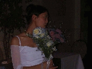 Jenny getting ready for the bouquet toss. Shes gonna chuck it real far. Photographer: Frank Wang