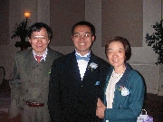 Mom and Dad Wang posing with Frank Photographer: Frank Wang