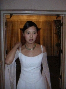 Jennys appears in her second wedding dress.  She made this one herself. Isnt she talented? Photographer: Frank Wang