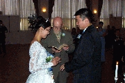 Jenny and Carl exchange rings. Photographer: James Wang