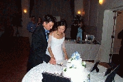 Carl and Jenny making the first cut into the cake. Photographer: James Wang